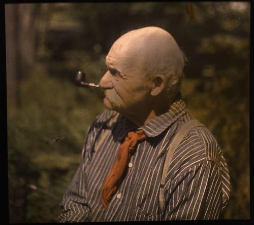 Mustached man smoking pipe