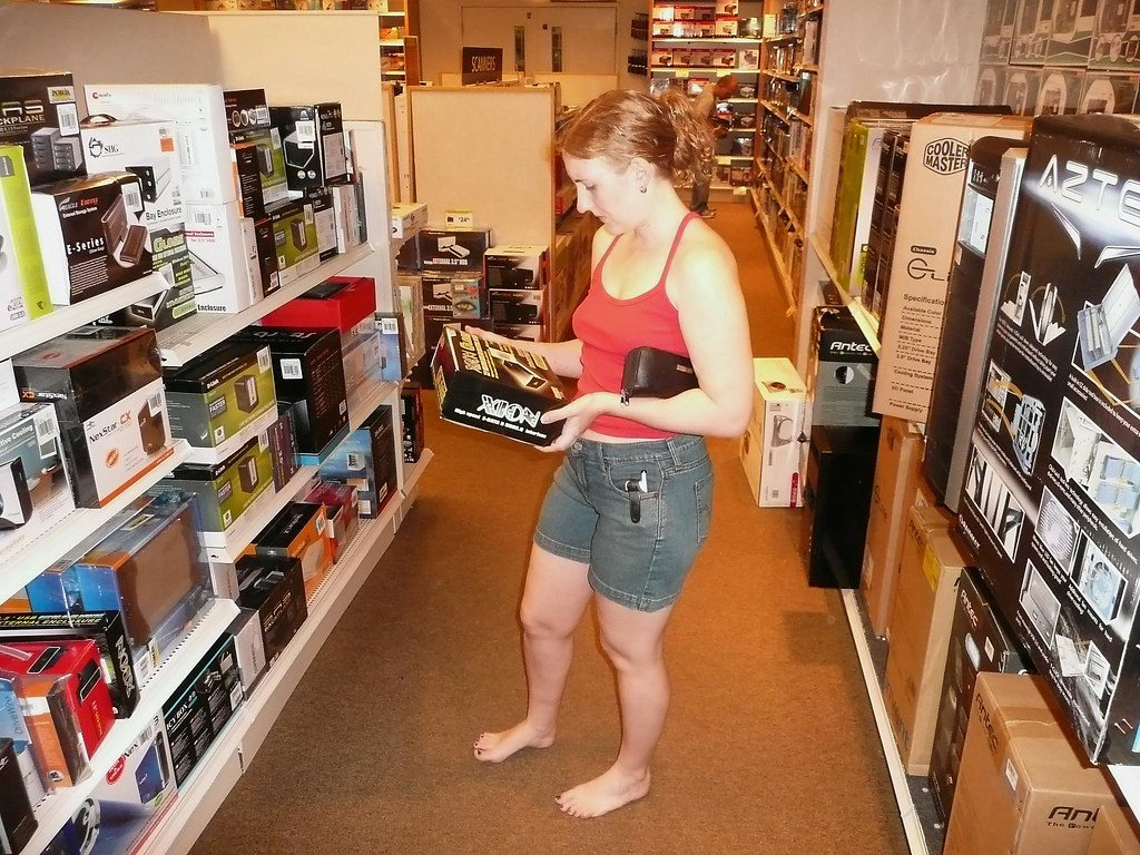 Every once in a while I take pictures when Sarah is shopping for obscure hardware in a computer warehouse store, wearing a tank top that shows off her super-heroes tattoos, and talking to me about our recent trip to Comic-Con….