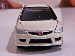 wheel(0.0), model car(1.0), automobile(1.0), automotive exterior(1.0), vehicle(1.0), automotive design(1.0), honda(1.0), honda civic type r(1.0), bumper(1.0), land vehicle(1.0),