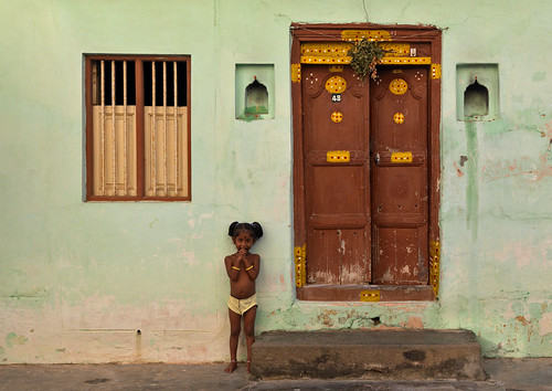 Girl and door in Puducherry, India
