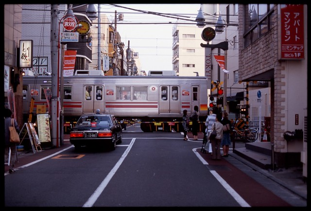 In Japan wherever you go there is a Taxi and a Train and some people