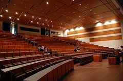 function hall(0.0), academic conference(0.0), theatre(0.0), ballroom(0.0), audience(0.0), conference hall(0.0), convention(1.0), performing arts center(1.0), auditorium(1.0), convention center(1.0),