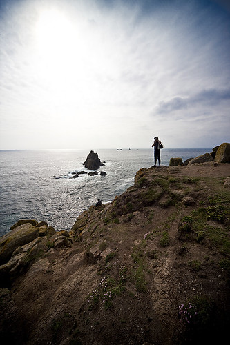Man on edge of cliffs, Lands End, Cornwall