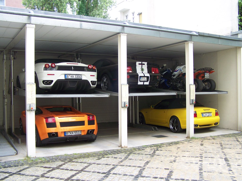 World 39 s most beautiful garages exotics 100 pics for Garage new s villejuif