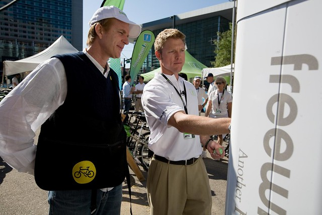 Nate shows Matthew Modine the CycleStation kiosk