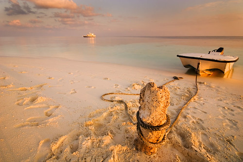Maldives Islands, Indian Ocean. The mother boat and the dinghy. Almost sunset hour, cloudy WB, tripod