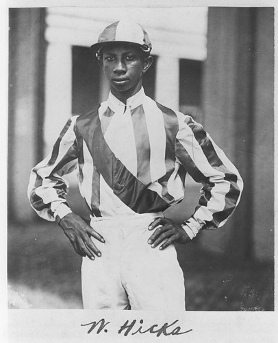 Black jockey in riding silks