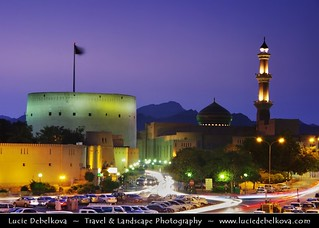 Oman - Nizwa - Fort and Mosque with Minaret lit at Dusk - Twilight - Blue Hour - Night