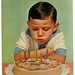 boy blowing candles