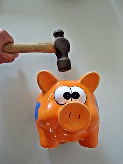 Piggy Bank being Smashed with Hammer