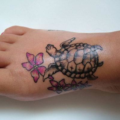 Foot tattoo flowers n turtle flickr photo sharing for Little turtle tattoo