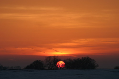 trees sunset sky orange sun snow clouds march horizon iowa markevans chimothy27