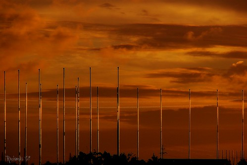 sunset orange glow guyana picnik flagpoles bej platinumphoto