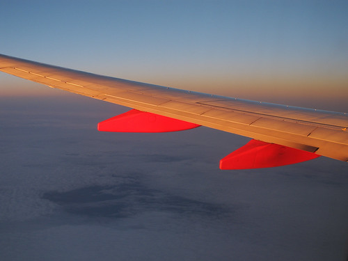 sunset red oklahoma clouds airplane evening aerial beltofvenus airplanewindowview