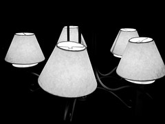 sconce(0.0), iron(0.0), lamp(1.0), light fixture(1.0), white(1.0), lampshade(1.0), monochrome photography(1.0), still life photography(1.0), black-and-white(1.0), lighting(1.0),