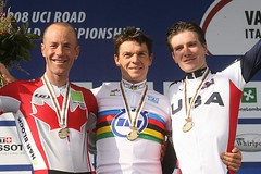 bicycle racing(0.0), vehicle(0.0), track cycling(0.0), podium(0.0), cycle sport(0.0), team(0.0), award(1.0), medal(1.0), athlete(1.0),