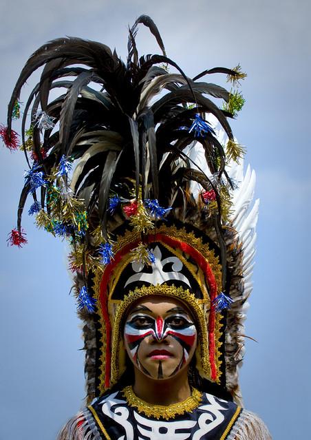 Traditional with wonderful feathered headdress in Borobudur, Java, Indonesia
