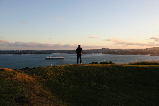 Guy is taking photos from Auckland & Waitemata Harbour - Mount Victoria