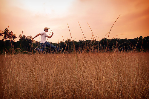 trees light sunset shadow summer portrait sky orange sun color field hat june shirt photoshop self d50 out dawn evening fly jump nikon open dusk farm wheat nolan wide jeans converse area wilson hunter 365 2008 timer tone allstar wellstone 365days hunterwilson