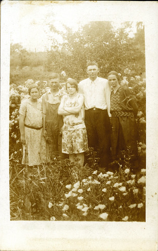 Five people standing in flowers