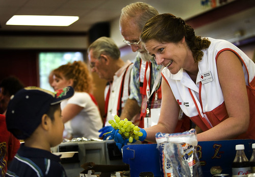 Worst hurricane ike Red Cross worker serves boy grapes