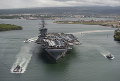 In this file photo, aircraft carrier USS Carl Vinson (CVN 70) departs Joint Base Pearl Harbor-Hickam with Sailors' friends and families aboard for a 'Tiger Cruise' in June 2011. (U.S. Navy photo by Mass Communication Specialist 2nd Class James R. Evans)