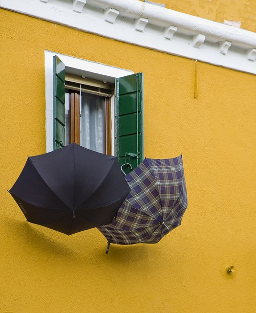 umbrellas at yellow house