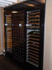 winery(0.0), wine cellar(1.0), furniture(1.0), display case(1.0), cabinetry(1.0),