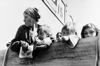 Russell Lee: Mexican woman and children looking over side of truck, Neches, Texas, 1939