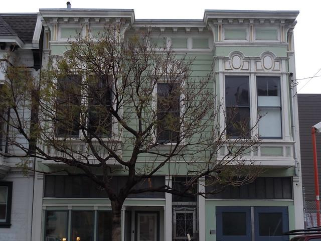 Squared bay windows over a victorian era storefront for Victorian era windows