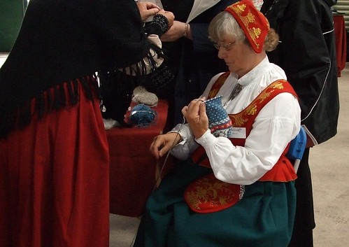 Norwegian knitters in traditional costume