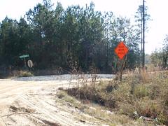 Gravel road sign closeup
