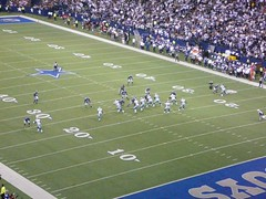 kick(0.0), soccer-specific stadium(0.0), football(0.0), american football(1.0), football player(1.0), sport venue(1.0), sports(1.0), tackle(1.0), player(1.0), gridiron football(1.0), ball game(1.0), touchdown(1.0), arena football(1.0), canadian football(1.0), stadium(1.0), arena(1.0),