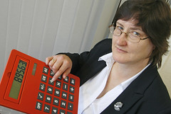 Phot of helpful accountant with large red calculator