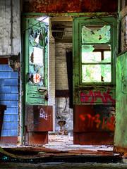 Door with broken glas between two halls (HDR)