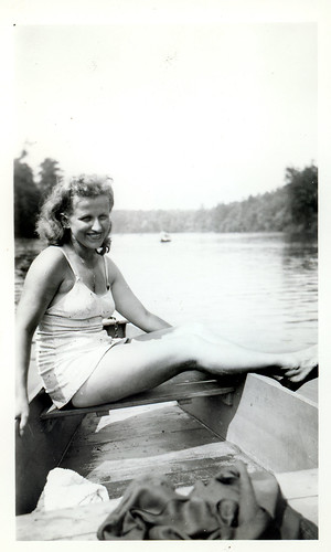 Thelma in white bathing suit in a rowboat 563