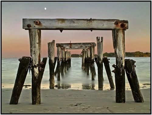 ocean moon water pier twilight sand massachusetts northshore beverly pilings beverlyfarms westbeach blueribbonwinner olympuse500 flickrsbest diamondclassphotographer goldstaraward qualitypixels globalworldawards oldnikkor28mmf28