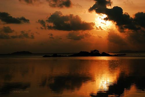 sky sun color reflection beach water silhouette clouds sunrise indonesia island nikon anniversary tokina rays sunrays bintan d80 goldstaraward 1116f28
