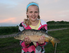 Rachel with Mirror Carp off the boards on Moss Lake on splash waggler 8mm pellet - 9th June 08