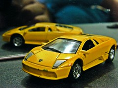 lamborghini countach(0.0), lamborghini diablo(0.0), model car(1.0), automobile(1.0), lamborghini(1.0), wheel(1.0), vehicle(1.0), automotive design(1.0), lamborghini(1.0), land vehicle(1.0), luxury vehicle(1.0), lamborghini murciã©lago(1.0), supercar(1.0), sports car(1.0),