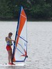 Girl Sailboarding at the Washington Sailing Marina by Kevin Borland
