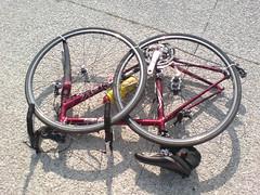 wheelchair(0.0), bicycle trailer(0.0), sports equipment(0.0), horse harness(0.0), cart(0.0), road bicycle(1.0), wheel(1.0), vehicle(1.0), rim(1.0), racing bicycle(1.0), bicycle wheel(1.0), bicycle frame(1.0), bicycle(1.0), spoke(1.0),