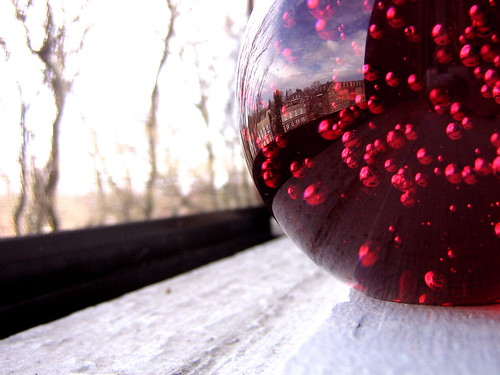 Accidental reflection in red ball.