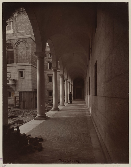 South wall of Courtyard showing length of arched walkway, construction of the McKim Building