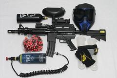 automotive exterior(0.0), shooting sport(0.0), shooting(0.0), sports(0.0), recreation(0.0), paintball equipment(1.0), weapon(1.0), games(1.0), firearm(1.0), gun(1.0), paintball(1.0),