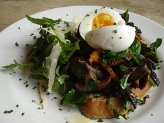 Wild mushrooms on toast with rocket and soft boile…