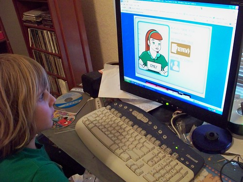 Child at computer.