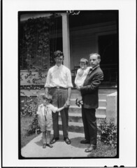Tennessee v. John T. Scopes Trial: Howard Gale Byrd, Charles Francis Potter, with Byrd's children John and Lillian, in front of Byrd's parsonage in Dayton, Tennessee. by Smithsonian Institution
