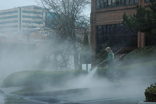 Working, steam cleaning the street in the rain, Seattle, Washington, USA by Wonderlane