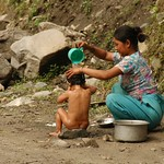 Mother Giving Child A Bath - Annapurna Circuit, Nepal